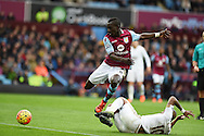 Idrissa Gana of Aston Villa is tackled by Swansea city's Andre Ayew.  Barclays Premier league match, Aston Villa v Swansea city at Villa Park in Birmingham, the Midlands on Saturday 24th October 2015.<br /> pic by  Andrew Orchard, Andrew Orchard sports photography.