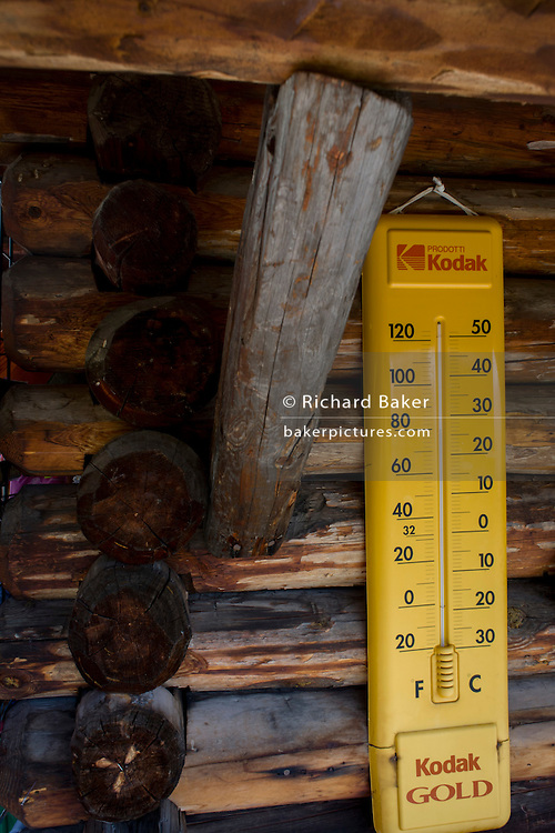 Old Kodak thermometer on the outside of a tourist hut on the Siusi plateau, above the South Tyrolean town of Ortisei-Sankt Ulrich in the Dolomites, Italy.