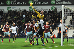 West Ham's Adrian punches the ball away from a cross - Photo mandatory by-line: Dougie Allward/JMP - Mobile: 07966 386802 - 02/12/2014 - SPORT - Football - West Bromwich - The Hawthorns - West Bromwich Albion v West Ham United - Barclays Premier League