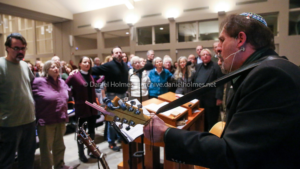 (10/29/18, WAYLAND, MA) Jonathan Zarkower, of Framingham, sings during the vigil at Temple Shir Tikva in Wayland on Monday. The vigil was held in the wake of the Pittsburgh mass shooting. [Daily News and Wicked Local Photo/Dan Holmes]
