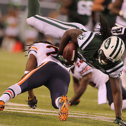 Chris Ivory, New York Jets, runs for a first down during the New York Jets Vs Chicago Bears, NFL regular season game at MetLife Stadium, East Rutherford, NJ, USA. 22nd September 2014. Photo Tim Clayton for the New York Times