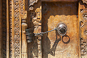 Traditional wooden carving on the door of building in Vashisht village in Kullu valley, Himachal Pradesh, India