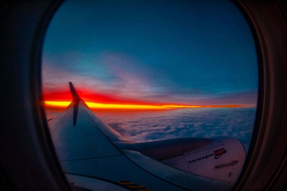 A Norwegian Air Shuttle Boeing 787 Dreamliner after take off predawn from Oslo Gardermoen Airport, Norway.