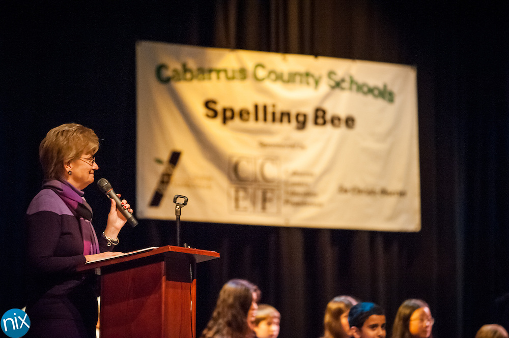 Dr. Marion Bish pronounces words for spellers during the Cabarrus County Schools Spelling Bee Wednesday night at Winkler Middle School in Concord.