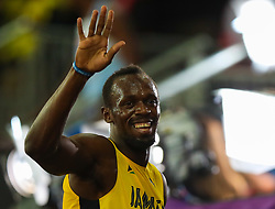 London, 2017-August-04. Usain Bolt waves at the crowd of Jamaican supporters after winning his Men's 100m heat at the IAAF World Championships London 2017. Paul Davey.