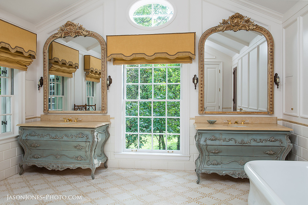 French country bathroom design with his and her (Jack and Jill) vanities, and a vintage clawfoot tub