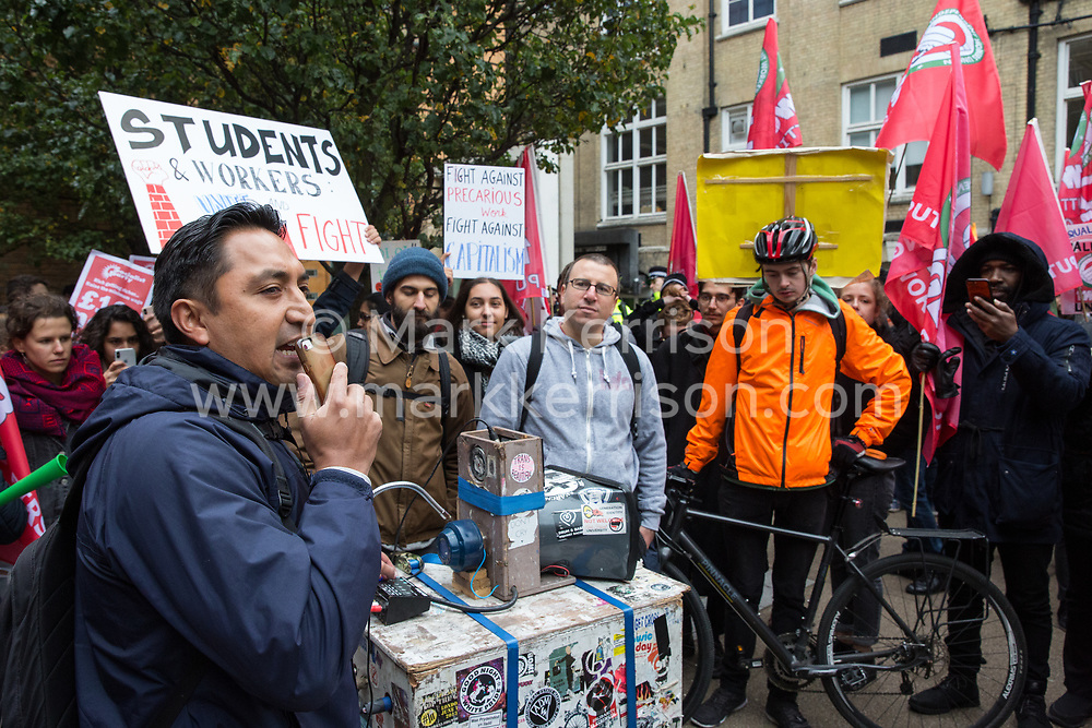 London, UK. 30th October, 2018. Henry Chango-Lopez, President of the  Independent Workers of Great Britain (IWGB) trade union, addresses members and supporters of the marching together with other precarious workers from the offices of Transport for London to the University of London via the Court of Appeal in support of Uber drivers who are seeking employment rights. The Court of Appeal will today hear an appeal by Uber against a ruling that its drivers are employees rather than self-employed workers.