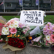 A message written 'It was a Monster not a Muslim' Flower tributes for the victims of terror attacks