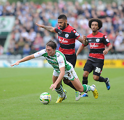 Yeovil Town's Luke Ayling  gets fouled by Queen Park Rangers' Armand Traore - Photo mandatory by-line: Alex James/JMP - Tel: Mobile: 07966 386802 21/09/2013 - SPORT - FOOTBALL - Huish Park - Yeovil - Yeovil Town V Queens Park Rangers - Sky Bet Championship