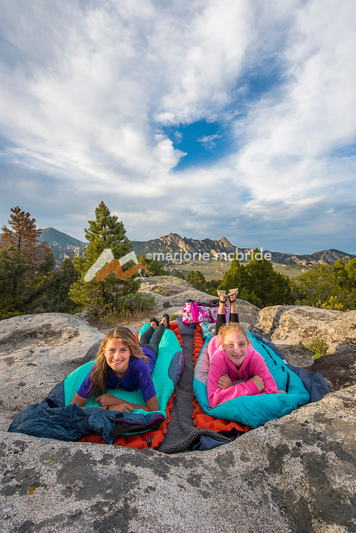 Young girls ready to sleep under the stars while camping at the City of Rocks National Reserve in Southern Idaho between Almo and Oakley, Idaho. MR