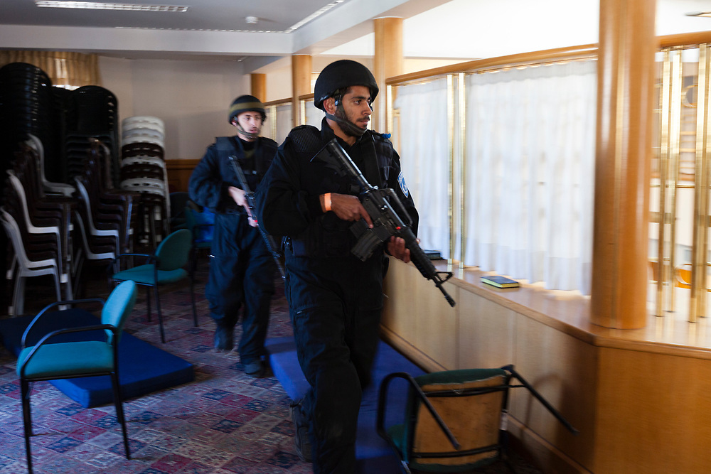 Israeli policemen search a religious Jewish Yeshiva next to the scene of an attack in a Synagogue in Jerusalem, Israel, on November 18, 2014. Two Palestinian men armed with axes, knives and guns  attacked worshippers praying inside the Synagogue, killing four people being shot dead by police, Israeli officials said.