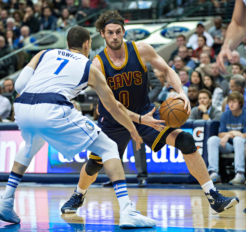DALLAS, TX - JANUARY 12:  Kevin Love #0 of the Cleveland Cavaliers drives to the basket while being guarded by Dwight Powell #7 of the Dallas Mavericks at American Airlines Center on January 12, 2016 in Dallas, Texas.  NOTE TO USER: User expressly acknowledges and agrees that, by downloading and or using this photograph, User is consenting to the terms and conditions of the Getty Images License Agreement.  The Cavaliers defeated the Mavericks 110-107.  (Photo by Wesley Hitt/Getty Images) *** Local Caption *** Kevin Love; Dwight Powell