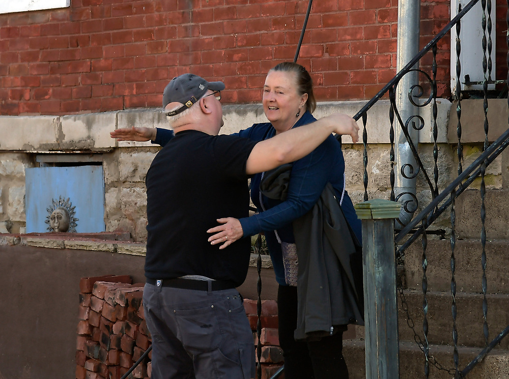 Neighbors console each other because of the tornado that ripped through that tore through East Nashville