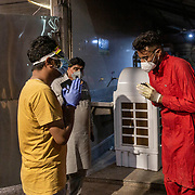 1 May 2021<br /> <br /> Indirapuram, Gazhiabad<br /> A relative of a patient who received oxygen  at the camp  organised by the temple thanks one of the volunteers (R ) for his help .