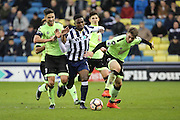 Millwall midfielder Fred Onyedinma (10) dribbling through Bournemouth players during the The FA Cup 3rd round match between Millwall and Bournemouth at The Den, London, England on 7 January 2017. Photo by Matthew Redman.