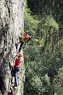 """Mayrhofen, Zillertal, Tyrol, Austria, September 2009. The Nasenwand klettersteig with safety cables and footholds has a degree of difficulty corresponding to category """"C-E"""" in the middle to upper range. In particular, its length and the level of exposure make it a really demanding """"Via Ferrata"""". The steep track goes through thin mountain forest and across outcrops of rock; and climbers have an impressive view over the mountaineering village during the entire course of the climb, which compensates for all the effort needed. The Zillertal region offers at least 5 via ferrata climbing routes, better known as Klettersteige. Photo by Frits Meyst/Adventure4ever.com"""