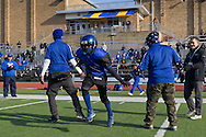 Newburgh, New York - A Middletown player runs onto the field during introductions before the Orange County Youth Football League Division II Super Bowl at Newburgh Free Academy on  Nov. 22, 2014.