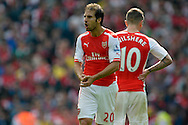 Arsenal's Mathieu Flamini reacts.  Barclays Premier league match, Arsenal v Manchester city at the Emirates Stadium in London on Saturday 13th Sept 2014.<br /> pic by John Patrick Fletcher, Andrew Orchard sports photography.