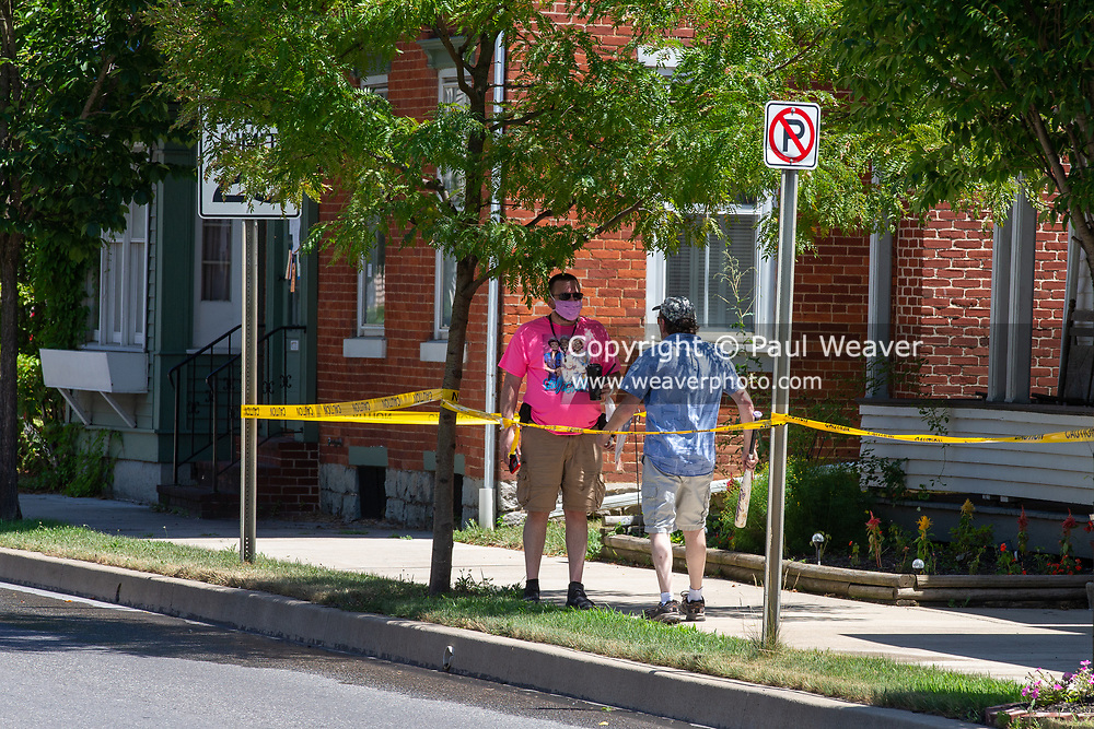 Vincent Yonai used yellow caution tape to block access to the sidewalk near his house on Chestnut Street. When a pedestrian used the sidewalk Yonai went after him with a metal bat.