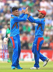 Afghanistan's Mujeeb Ur Rahman (left) celebrates taking the wicket of Bangladesh's Shakib Al Hasan during the ICC Cricket World Cup group stage match at The Hampshire Bowl, Southampton.