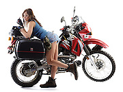 """Gary Miller's Kawasaki KLR motorcycle shot in studio for article on """"The Ultimate KLR"""" for Adventure Rider Magazine.  Taylor Reazin is model."""