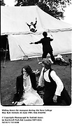 Sliding down the marquee during the New College May Ball. Oxford. 24 June 1983. film 83445f6<br />