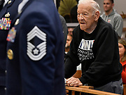 """U.S. Army Air Corps veteran Fred Bruss, 95 of Freeburg, stands during the playing of the U.S. Air Force theme song during a medley of Armed Forces songs. Veterans stood when their song was played. Bruss served during World War II in the Army Air Corps, which was the predecessor of today's Air Force. Bruss also was on the Belleville Fire Department for 30 years. The song was originally entitled """"Army Air Corps"""" but was changed to its current title of """"U.S. Air Force"""" in 1947, shortly after the formation of the Air Force branch of the military. The city of Belleville held their 21st annual Veterans Day ceremony inside Belleville City Hall on Thursday November 11, 2019. It was moved inside due to the winter weather.<br /> Photo by Tim Vizer"""
