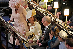 Left to right) The Prince of Wales, the Duchess of Cornwall, the Duchess of Cambridge, the Duke of York, Princess Beatrice and Princess Eugenie sitting in St George's Chapel at Windsor Castle during the wedding of Prince Harry and Meghan Markle.