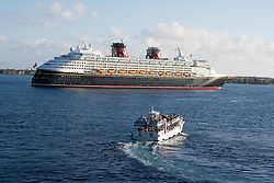 passenger boat making its way to a cruise liner