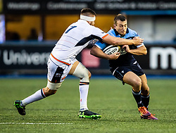 Garyn Smith of Cardiff Blues under pressure from Luke Crosbie of Edinburgh Rugby<br /> <br /> Photographer Simon King/Replay Images<br /> <br /> Guinness PRO14 Round 2 - Cardiff Blues v Edinburgh - Saturday 5th October 2019 -Cardiff Arms Park - Cardiff<br /> <br /> World Copyright © Replay Images . All rights reserved. info@replayimages.co.uk - http://replayimages.co.uk