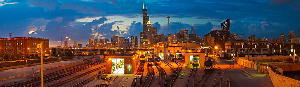 Chicago's skyline as shot from the 18th street bridge on a summer evening. Showing the Chicago river, rail yards, Roosevelt Road bridge and skyline. Exterior Architectural Photography. Buildings, locations, architecture. Chicago, Illinois, built landscape,