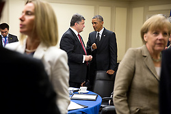President Barack Obama speaks with President Petro Poroshenko of Ukraine following a meeting with leaders from Italy, France, Germany and the United Kingdom at the Celtic Manor Resort in Newport, Wales, Sept. 4, 2014. (Official White House Photo by Pete Souza)<br /> <br /> This official White House photograph is being made available only for publication by news organizations and/or for personal use printing by the subject(s) of the photograph. The photograph may not be manipulated in any way and may not be used in commercial or political materials, advertisements, emails, products, promotions that in any way suggests approval or endorsement of the President, the First Family, or the White House.