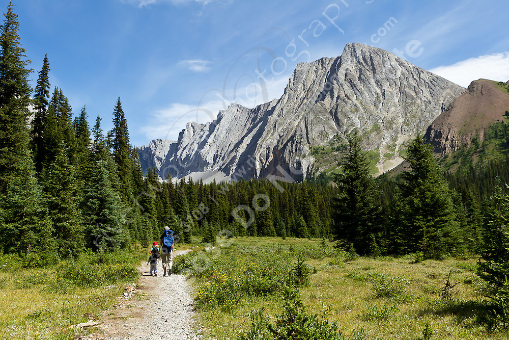 Another family hiking trip, this time to Chester Lake in Kananaskis. We did an approximately 10 km round trip, including 320m of elevation gain. Andrew walked all the way up to the lake, but got a ride (and a nap) in the backpack for part of the way back down. It was  a beautiful hike and the highlight was loads of fresh wild strawberries beside the trail!<br /> <br /> ©2010, Sean Phillips<br /> http://www.RiverwoodPhotography.com