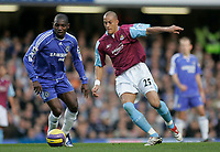 Photo: Marc Atkins.<br />Chelsea v West Ham United. The Barclays Premiership. 18/11/2006. Geremi of Chelsea in action with Bobby Zamora of West Ham.