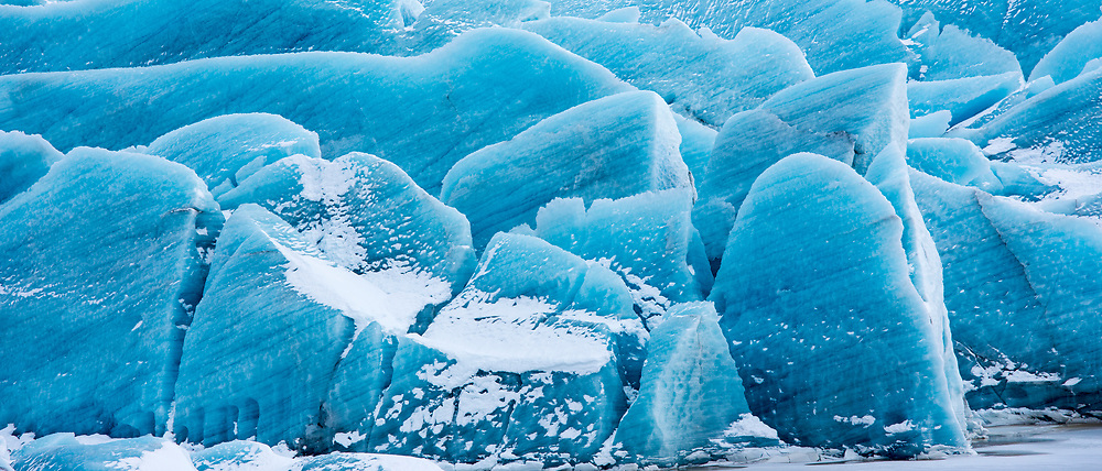 Close up showing layers in ice blocks of glacial tongue of Svinafellsjokull glacier an outlet glacier of Vatnajokull, South Iceland