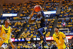 Dec 8, 2018; Morgantown, WV, USA; Pittsburgh Panthers guard Sidy N'Dir (11) shoots during the first half against the West Virginia Mountaineers at WVU Coliseum. Mandatory Credit: Ben Queen-USA TODAY Sports