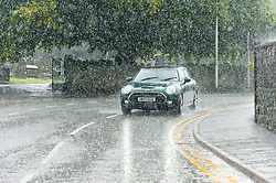 © Licensed to London News Pictures. 17/08/2020. Builth Wells, Powys, Wales, UK. Cars drive through heavy rain in the small Welsh market town of Builth Wells in Powys, UK. Photo credit: Graham M. Lawrence/LNP