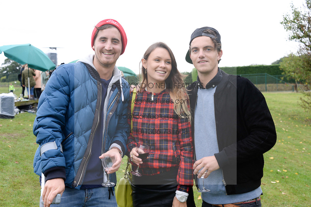 Left to right, OLIVER HADDEN-PATON, EMILY WEBBER and VISCOUNT ERLEIGH at the Ripley Football Tournament hosted by Irene Forte in aid of The Samaritans held at Ryde Farm, Hungry Hill Lane, Ripley, Surrey on 14th September 2013.  After the football guests enjoyed an after party.