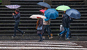 A historic snowstorm hit southern Italy stopping buses, planes, and trains for three days.<br /> Umbrells and wind accompanied the weather in this Napoli street scene.