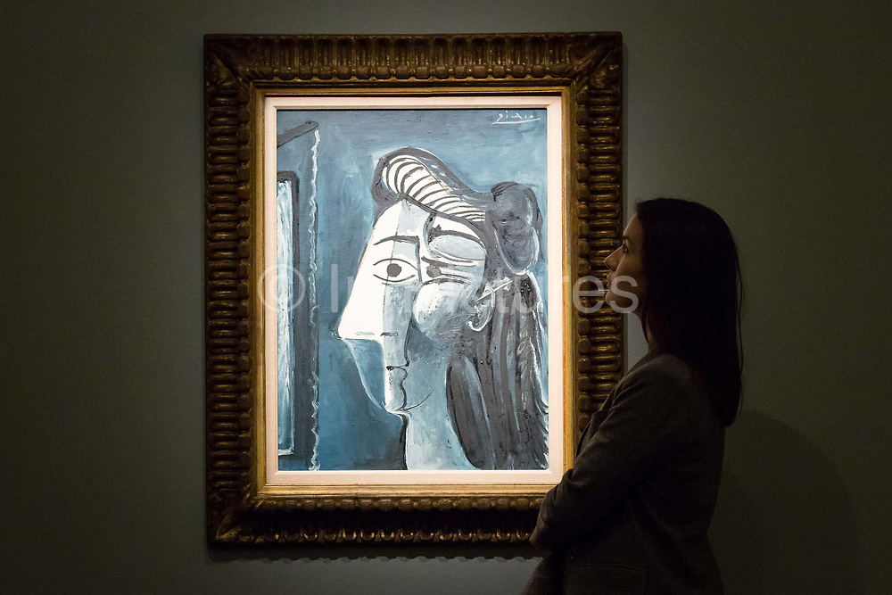 A member of staff looks at Pablo Picassos Tete de femme on February 22nd, 2018 at the preview for Sothebys upcoming Impressionist, Modern and Surrealist Art auction at Sothebys in New Bond Street, London, England.