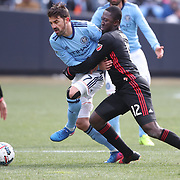 NEW YORK, NEW YORK - March 12:  David Villa #7 of New York City FC is challenged by Patrick Nyarko #12 of D.C. United during the NYCFC Vs D.C. United regular season MLS game at Yankee Stadium on March 12, 2017 in New York City. (Photo by Tim Clayton/Corbis via Getty Images)