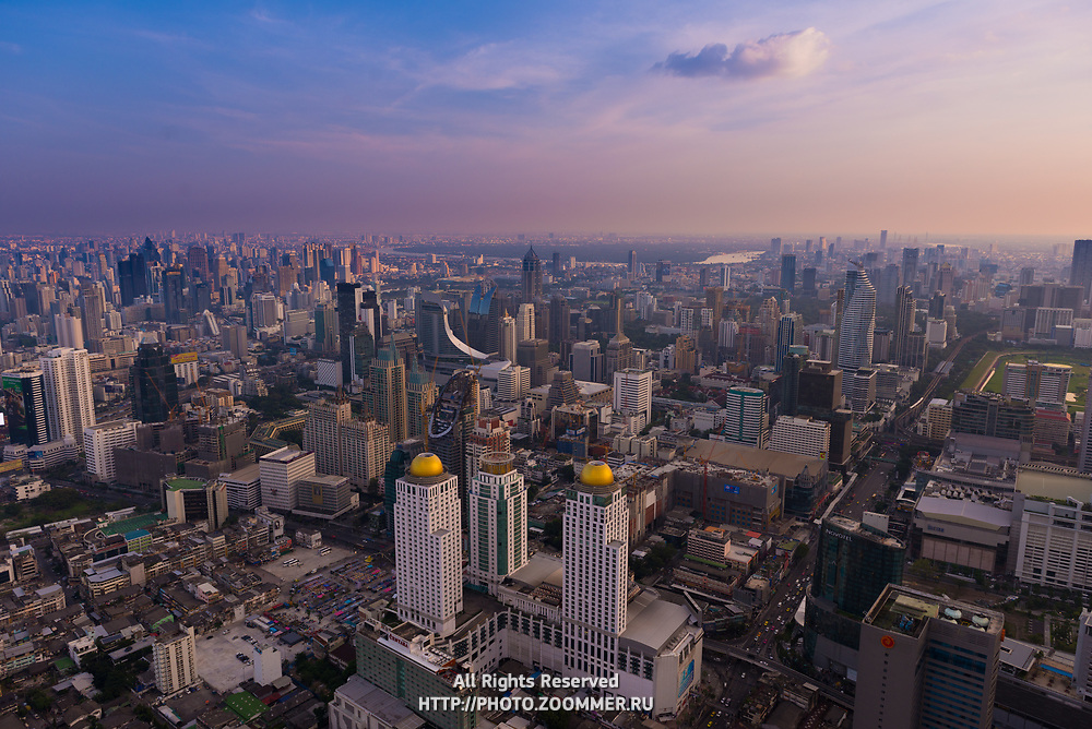 Aerial view of Bangkok downtown with skyscrapers and night markets