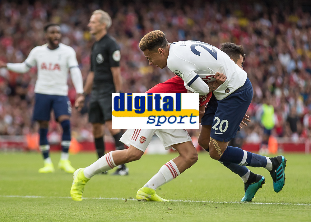 Football - 2019 / 2020 Premier League - Arsenal vs. Tottenham Hotspur<br /> <br /> In an incident missed by VAR and the referee Dani Ceballos (Arsenal FC) wrestles with Dele Alli (Tottenham FC) as they wait for the game to restart at The Emirates.<br /> <br /> COLORSPORT/DANIEL BEARHAM