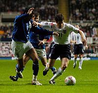 Photo. Jed Wee, Digitalsport<br /> England v Azerbaijan, World Cup Qualifier, 30/03/2005.<br /> England's Joe Cole (R) tries to get away from Azerbaijan's Aftandil Hajiyev.