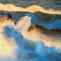 Heavy surf waves roll ashore from the Pacific Ocean at Gray Whale Cove State Beach near Montara, California.