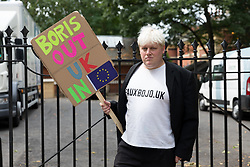 © Licensed to London News Pictures. 30/07/2018. London, UK. A Boris Johnson look-a-like anti Brexit protester outside the Foreign Secretary's official residence at Carlton Gardens in central London where the former Foreign Secretary, Boris Johnson is moving out following his resignation.  Photo credit: Vickie Flores/LNP