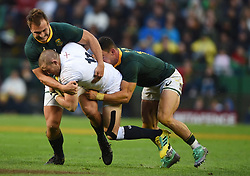 Cape Town-180623-  Mike Brown of England tackled by Andre Esterguizen and Jesse Kriel of South Africa of England  in the last game of the Castle Lager Test between Springboks and England at Newlands Stadium photographer:Phando Jikelo/African News Agency/ANA