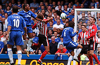 Fotball<br /> Foto: Fotosports/Digitalsport<br /> NORWAY ONLY<br /> <br /> Date: 28/08/2004<br /> <br /> Chelsea v Southampton FA Barclays Premiership<br /> <br /> Claus Lundekvam handles ball for Chelsea Penalty<br /> <br /> Didier Drogba Chelsea.