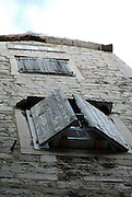 Ancient stone walls, medieval shutters, and air conditioner. Diocletian Palace, Split, Croatia