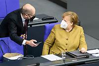 11 FEB 2021, BERLIN/GERMANY:<br /> Olaf Scholz (L), SPD, Bundesfinanzminister, und Angela Merkel (R), CDU, Bundeskanzlerin, im Gespraech, waehrend der Debatte nach Merkels Regierungserklaerung zur Bewaeltigung der Corvid-19-Pandemie, Plenum, Reichstagsgebaeude, Deutscher Bundestag<br /> IMAGE: 20210211-01-093<br /> KEYWORDS: Corona, Mundschutz, Maske, Gespräch